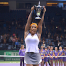 Serena Williams of the USA shows her trophy after her victory over Li Na of China in the final of the WTA Championship in Istanbul, Turkey, Sunday, Oct. 27, 2013. The world's top female tennis players compete in the championships which runs from Oct. 22 until Oct. 27.(AP Photo)