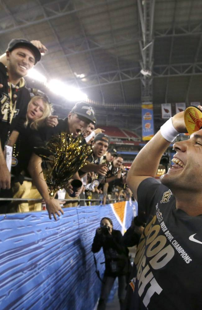 Central Florida's Blake Bortles smiles as he celebrates with fans after the Fiesta Bowl NCAA college football game win against Baylor Wednesday, Jan. 1, 2014, in Glendale, Ariz.  Central Florida defeated Baylor 52-42
