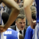 Creighton head coach Greg McDermott talks to his team during a timeout during the second period of a NCAA college basketball game at SIU Arena in Carbondale, Ill., Sunday, Jan. 27, 2013. (AP Photo/Stephen Lance Dennee)
