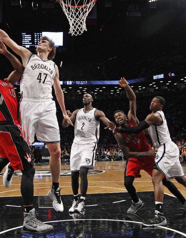 Brooklyn Nets forward Andrei Kirilenko (47) defends as Toronto Raptors guard DeMar DeRozan (10) goes up for a layup in the second half of Game 4 of an NBA basketball first-round playoff series at the Barclays Center, Sunday, April 27, 2014, in New York. The Raptors evened the series at 2-2 defeating the Nets 87-79