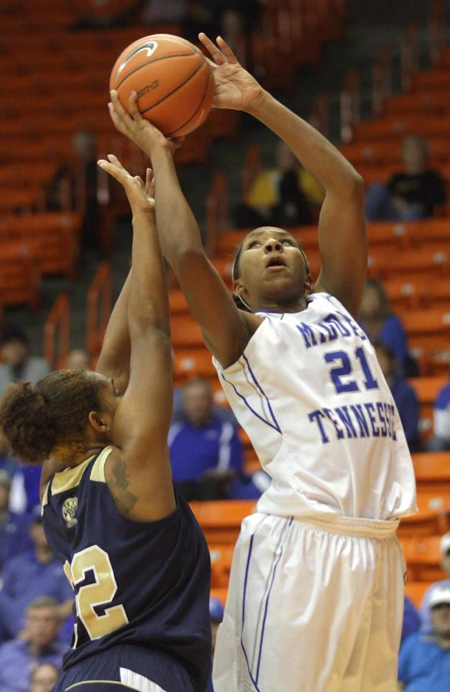 Middle Tennessee's Ebony Rowe scores over Florida International's Jerica Coley during the second half  of an NCAA college basketball semifinal game at the women's Conference USA tournament, Friday March 14, 2014 in El Paso, Texas