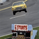 A stunt driver gets airborne while performing before the NASCAR Sprint Cup Series Showdown and All-Star auto races at Charlotte Motor Speedway in Concord, N.C., Saturday, May 18, 2013. (AP Photo/Gerry Broome)