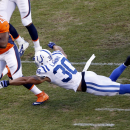 Denver Broncos running back C.J. Anderson (22) escapes the reach of Indianapolis Colts strong safety LaRon Landry (30) during the first half of an NFL football game, Sunday, Sept. 7, 2014, in Denver The Associated Press