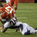 Kansas City Chiefs wide receiver Donnie Avery (17) fumbles the ball for a turnover after being hit by Denver Broncos free safety Rahim Moore (26) in the second half of an NFL football game in Kansas City, Mo., Sunday, Nov. 30, 2014 The Associated Press
