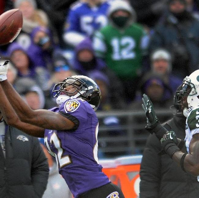 Baltimore Ravens wide receiver Torrey Smith pulls in a pass under pressure from New York Jets cornerback Antonio Cromartie, right, during the first half of an NFL football game in Baltimore, Md., Sunday, Nov. 24, 2013