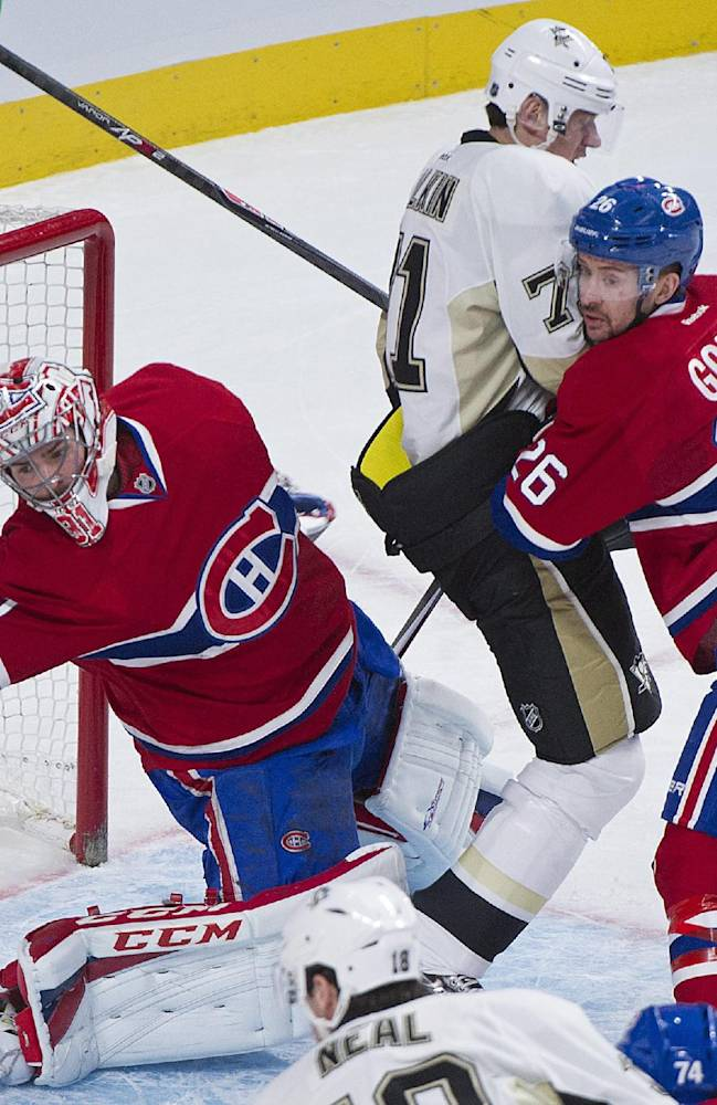 Montreal Canadiens goaltender Carey Price, left, loses his stick as Pittsburgh Penguins center Evgeni Malkin, center, moves in and Canadiens defenseman Josh Gorges defends during second-period NHL hockey game action in Montreal, Saturday, Nov. 23, 2013