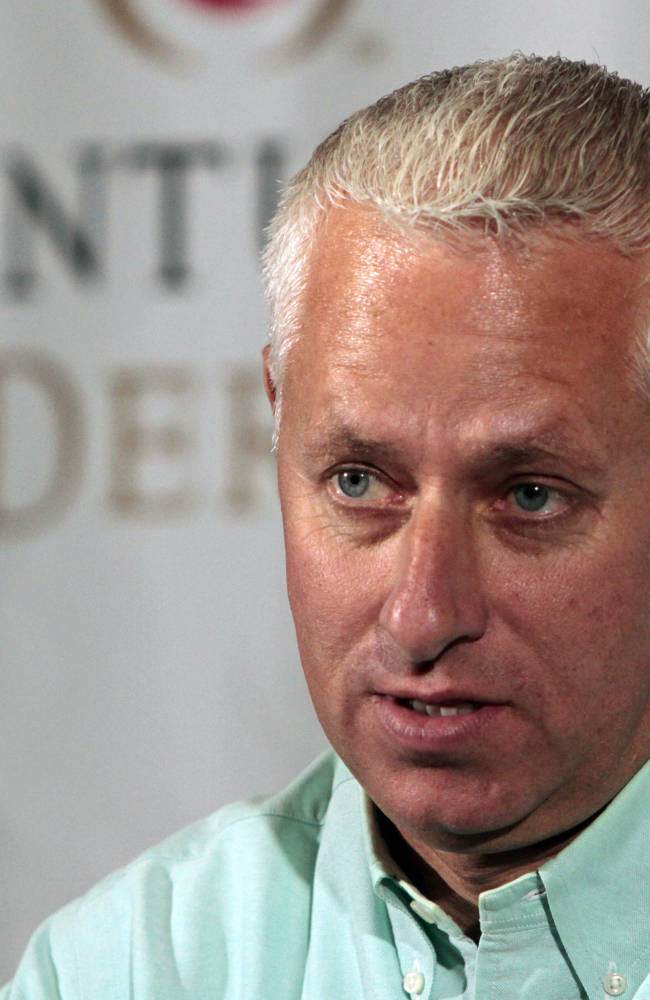 In this April  27, 2013 file photo, trainer Todd Pletcher talks about his Kentucky Derby entrants during a news conference at Churchill Downs in Louisville, Ky. Pletcher is taking aim at winning his second Kentucky Derby with four horses this year