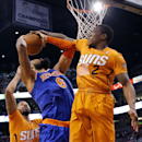 New York Knicks' Tyson Chandler (6) has his shot blocked by Phoenix Suns' Eric Bledsoe (2) during the first half of an NBA basketball game, Friday, March 28, 2014, in Phoenix The Associated Press