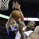 San Antonio Spurs' Kawhi Leonard (2) and Dallas Mavericks' Dirk Nowitzki, left, of Germany, fight for a rebound during the first half of Game 2 of the opening-round NBA basketball playoff series on Wednesday, April 23, 2014, in San Antonio The Associated
