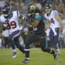 In this Dec. 5, 2013, file photo, Jacksonville Jaguars wide receiver Ace Sanders (18) returns a punt for yardage as he is chased by Houston Texans tight end Jake Byrne (89) and Ryan Griffin (84) during the first half of an NFL football game in Jacksonvill