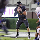 East Carolina's Shane Carden (5) prepares to pass during an NCAA college football game against Connecticut, Thursday, Oct. 23, 2014, in Greenville, N.C. (AP Photo/The Daily Reflector, Aileen Devlin)