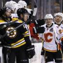 Calgary Flames left wing Jiri Hudler (24) is congratulated by teammates after his goal against the Boston Bruins during the second period of an NHL hockey game in Boston, Thursday, March 5, 2015. (AP Photo/Charles Krupa)