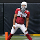 Arizona Cardinals wide receiver Larry Fitzgerald stretches during an NFL football training camp, Monday, Aug. 11, 2014, in Glendale, Ariz The Associated Press
