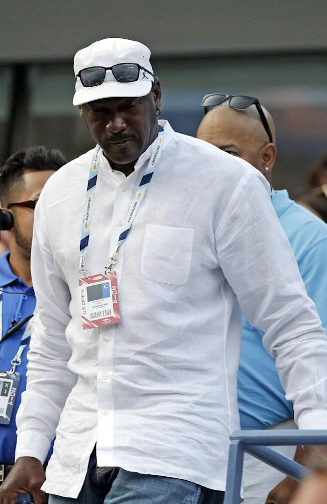 Michael Jordan arrives for a match between Roger Federer, of Switzerland, and Marinko Matosevic, of Australia, in the first round of the 2014 U.S. Open tennis tournament Tuesday, Aug. 26, 2014, in New York
