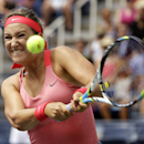 Victoria Azarenka, of Belarus, returns a shot to Alize Cornet, of France, during the third round of the 2013 U.S. Open tennis tournament, Saturday, Aug. 31, 2013, in New York. (AP Photo/David Goldman)