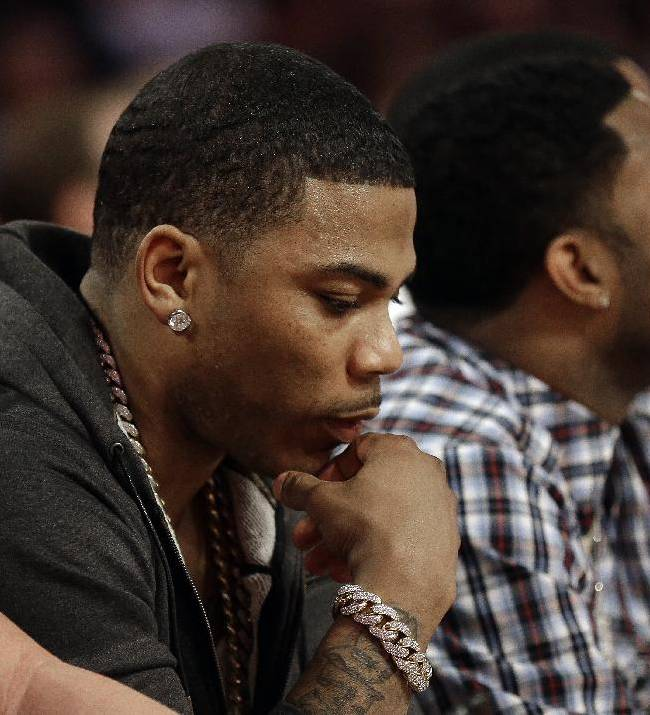 Rapper Nelly sits near the court during the skills competition at the NBA All Star basketball game, Saturday, Feb. 15, 2014, in New Orleans