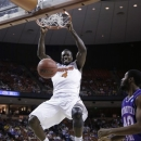 Florida's Patric Young (4) scores in front of Northwestern State's Marvin Frazier, right, during the first half of a second-round game of the NCAA men's college basketball tournament Friday, March 22, 2013, in Austin, Texas. (AP Photo/David J. Phillip)
