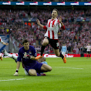 Sunderland's Fabio Borini, top, is thwarted by Manchester City's goalkeeper Costel Pantilimon during the League Cup Final at Wembley Stadium, London, England, Sunday March 2, 2014
