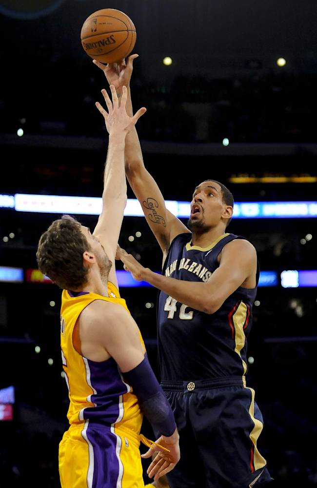 New Orleans Pelicans center Alexis Ajinca (42), of France, shoots over Los Angeles Lakers center Pau Gasol (16), of Spain, during the first half of an NBA basketball game, Tuesday, March 4, 2014, in Los Angeles