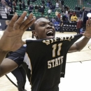 Wichita State's Cleanthony Early (11) celebrates after his team defeated Gonzaga 76-70 during a third-round game in the NCAA men's college basketball tournament in Salt Lake City Saturday, March 23, 2013. (AP Photo/Rick Bowmer)