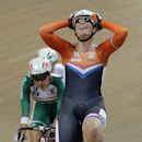 Kirsten Wild of the Netherlands celebrates after winning the final of the Women's Scratch 10 km race at the Track Cycling World Championships in Saint-Quentin-en-Yvelines, outside Paris, France, Saturday, Feb. 21, 2015. (AP Photo/Christophe Ena)