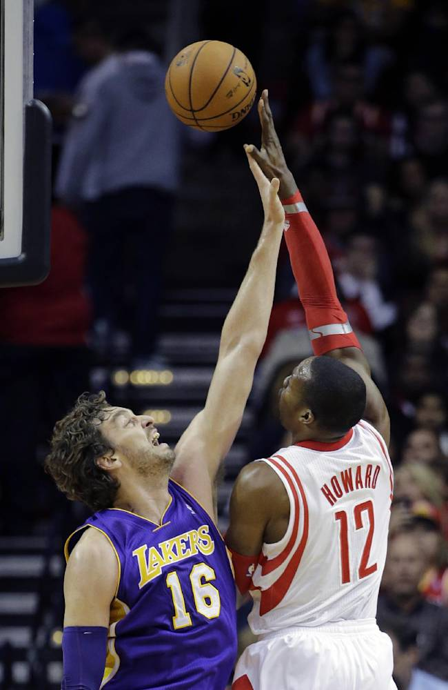 Houston Rockets' Dwight Howard (12) shoots over Los Angeles Lakers' Pau Gasol (16) during the first quarter of an NBA basketball game Thursday, Nov. 7, 2013, in Houston