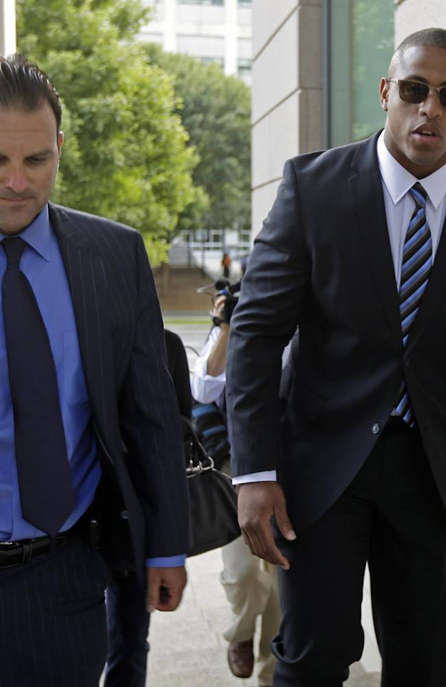 Carolina Panthers' Greg Hardy, right, arrives with agent Drew Rosenhaus at the Mecklenburg County courthouse in Charlotte, N.C., Tuesday, July 15, 2014, for Hardy's domestic assault trial,