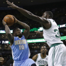 Denver Nuggets' Nate Robinson (10) shoots against Boston Celtics' Brandon Bass (30) in the first quarter of an NBA basketball game in Boston, Friday, Dec. 6, 2013 The Associated Press