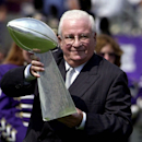 This Sept. 9, 2001 file photo shows Baltimore Ravens owner Art Modell acknowledging the fans while holding the Vince Lombardi Super Bowl trophy prior to the Super Bowl game against the Chicago Bears, in Baltimore. Former Ravens owner Modell has died. He