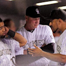 Colorado Rockies' Franklin Morales, right, talks with Wilin Rosario, left, after leaving the game during the eighth inning of a baseball game, Tuesday, April 22, 2014, in Denver. The Rockies win 2-1 The Associated Press