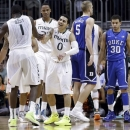 Miami's Shane Larkin (0) celebrates after Durand Scott (1) scored against Duke during the first half of an NCAA college basketball game in Coral Gables, Fla., Wednesday, Jan. 23, 2013. (AP Photo/Alan Diaz)