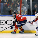 Florida Panthers right wing Krys Barch (21) and Montreal Canadiens defenseman Francis Bouillon (55) race for the puck during the third period of an NHL hockey game in Sunrise, Fla., on Saturday, March 29, 2014 The Associated Press