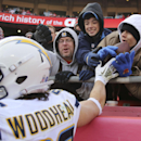 San Diego Chargers running back Danny Woodhead (39) hands the ball to fans after his touchdown during the first half of an NFL football game in Kansas City, Mo., Sunday, Nov. 24, 2013 The Associated Press