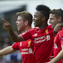 Liverpool's Raheem Sterling, center, celebrates with teammates Joe Allen, right, and Alberto Moreno after scoring against Tottenham Hotspur, during their English Premier League soccer match at White Hart Lane, London, Sunday, Aug. 31, 2014 (AP Photo/Bogda