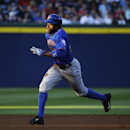 New York Mets' Eric Young advances to third base on a throwing error by Atlanta Braves catcher Ryan Doumit after stealing second base in the first inning of a baseball game, Thursday, April 10, 2014, in Atlanta The Associated Press