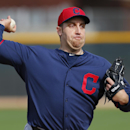 In this Feb. 21, 2014 file photo, Cleveland Indians pitcher Aaron Harang throws during spring training baseball practice in Goodyear, Ariz. Atlanta released pitcher Freddy Garcia, who was contending for a spot in the Braves' battered rotation, and agreed