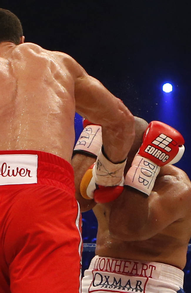 IBF, WBA, WBO and IBO champion Wladimir Klitschko from Ukraine, left, knocks out his Australian challenger Alex Leapai during their heavyweight world title bout in Oberhausen, western Germany, Saturday, April 26, 2014