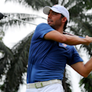 Pablo Larrazabal of Spain watches his shot on the sixth hole during the third round of the EurAsia Cup golf tournament at the Glenmarie Golf and Country Club in Subang, Malaysia, Saturday, March 29, 2014. (AP Photo/Joshua Paul)