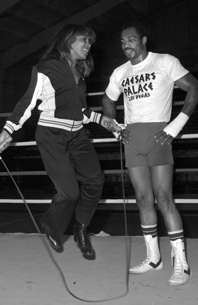 In this 1977 photo provided by the Las Vegas News Bureau, former heavyweight boxing champion Ken Norton helps Tina Turner jump rope in the ring at Caesars Palace in Las Vegas. Norton, who beat Muhammad Ali and later lost a controversial decision to him in Yankee Stadium, died Wednesday, Sept. 18, 2013, at a Las Vegas care facility, his son said. He was 70