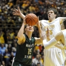 Wright State guard Kendall Griffin, left, drives the lane while Valparaiso forward Kevin Van Wijk defends during first half action in a NCAA college basketball game Tuesday March 12, 2013 in Valparaiso, Ind. (AP Photo/Joe Raymond)