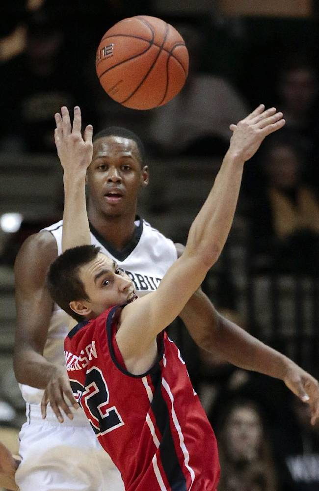 Mississippi guard Marshall Henderson (22) reaches for a pass by Vanderbilt forward Rod Odom, top, in the second half of an NCAA college basketball game Wednesday, Jan. 22, 2014, in Nashville, Tenn. Mississippi won 63-52