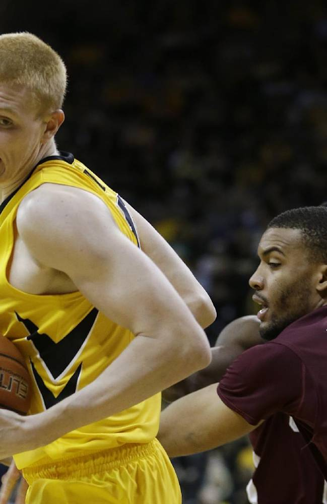 Iowa forward Aaron White drives around Maryland-Eastern Shore forward Shane Randall, right, during the first half of an NCAA college basketball game, Thursday, Nov. 14, 2013, in Iowa City, Iowa