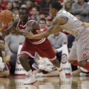 Indiana's Victor Oladipo, left, grabs a loose ball away from Ohio State's Lenzelle Smith during the second half of an NCAA college basketball game on Sunday, Feb. 10, 2013, in Columbus, Ohio. Indiana defeated Ohio State 81-68. (AP Photo/Jay LaPrete)