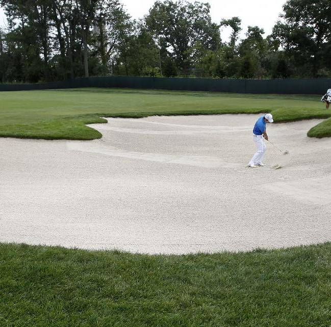 Seung-yul Noh, of South Korea, hits from a bunker on the 13th hole during the first round of play at The Barclays golf tournament Thursday, Aug. 21, 2014, in Paramus, N.J