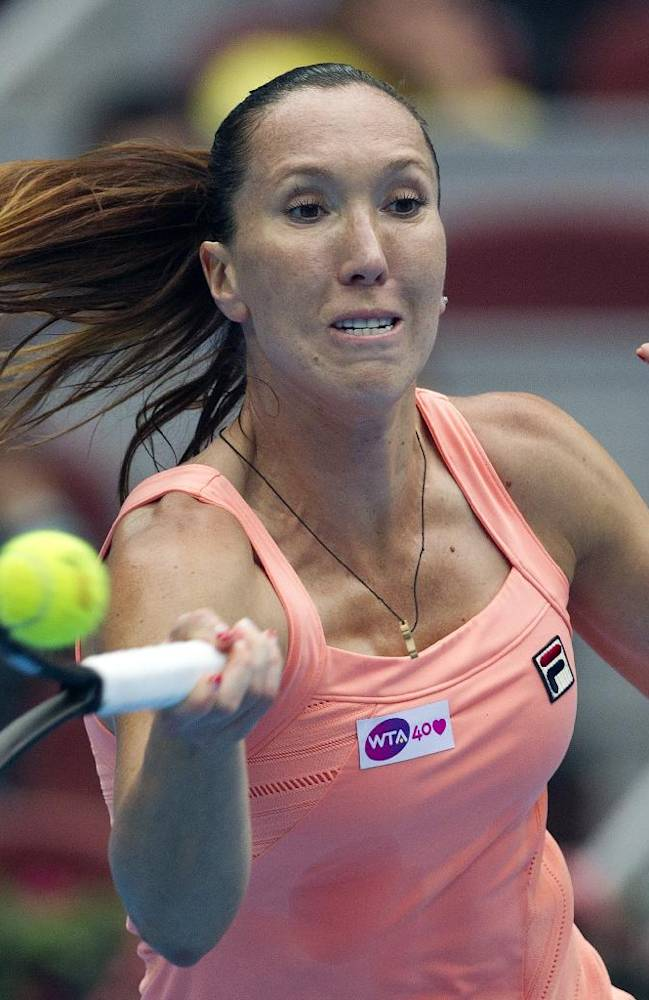 Jelena Jankovic of Serbia returns a shot to Petra Kvitova of the Czech Republic during the semifinal match of the China Open tennis tournament at the National Tennis Stadium in Beijing, China Saturday, Oct. 5, 2013