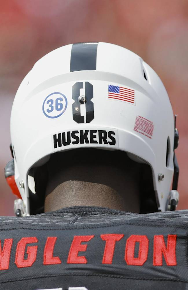 Nebraska defensive back D.J. Singleton (8) has a 36 sticker on the back of his helmet as he and the whole Nebraska team honor UCLA wide receiver Nick Pasquale (36) who was killed earlier in the week in the first half of an NCAA college football game against UCLA, in Lincoln, Neb., Saturday, Sept. 14, 2013