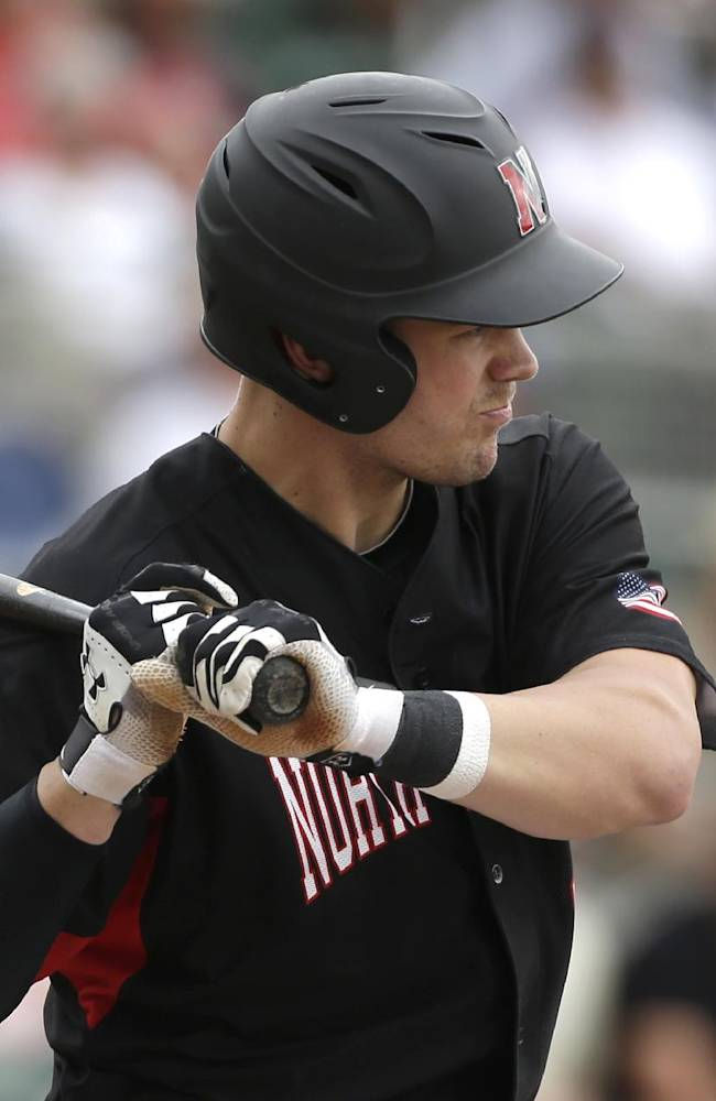 Northeastern's Brad Burcroff watches a pitch by Boston Red Sox's Brandon Workman in the first inning of an exhibition baseball game, Thursday, Feb. 27, 2014, in Fort Myers, Fla
