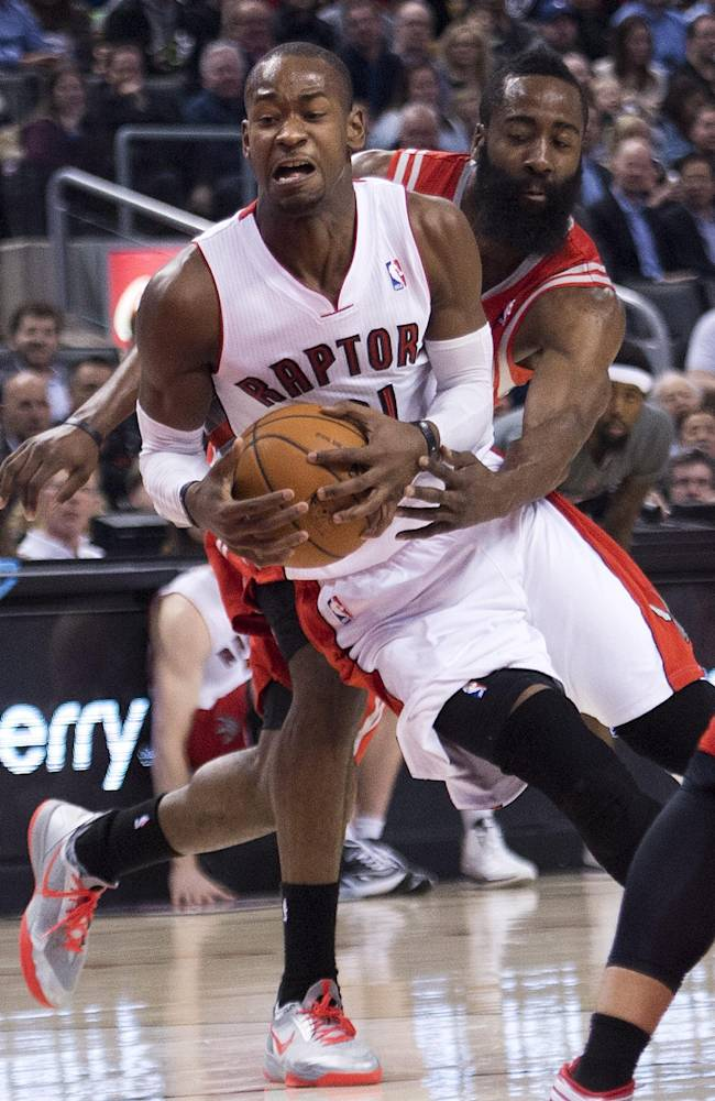 Toronto Raptors forward Terrence Ross, front, controls the ball past Houston Rockets guard James Harden, back, during first-half NBA basketball action in Toronto, Wednesday, April 2, 2014