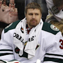 Minnesota Wild goalie Ilya Bryzgalov watches from the bench in the first period of an NHL preseason hockey game against the Pittsburgh Penguins in Pittsburgh, Thursday, Sept. 25, 2014. The Associated Press