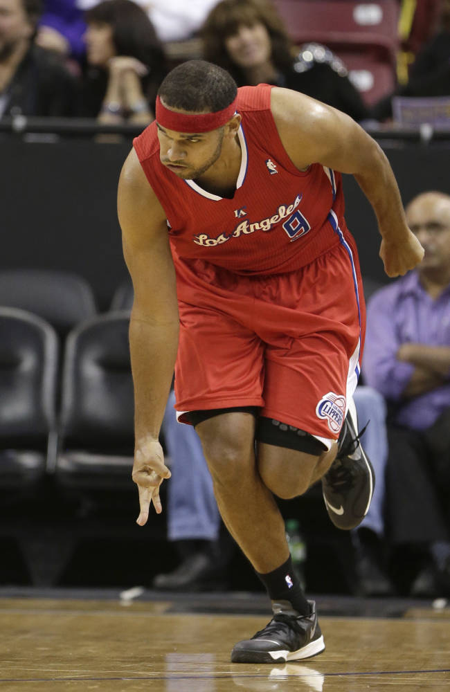 Los Angeles Clippers forward Jared Dudley flashes three fingers after scoring a three-point basket during the third quarter of an NBA basketball game against the Sacramento Kings in Sacramento, Calif., Friday, Nov. 1, 2013. The Clippers won 110-101